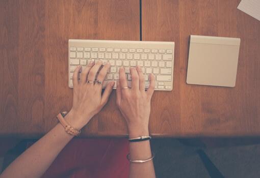 hands-woman-apple-desk-medium