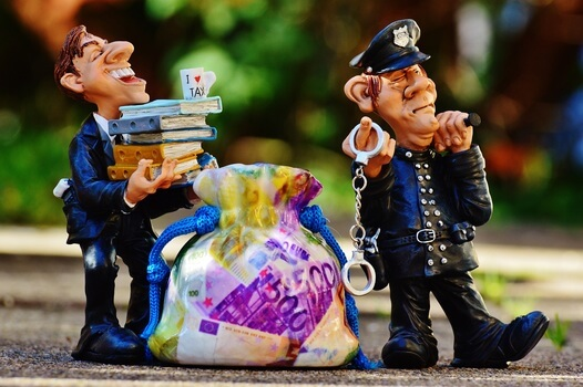 taxes-tax-evasion-police-handcuffs-medium