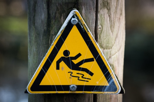 sign-slippery-wet-caution-medium