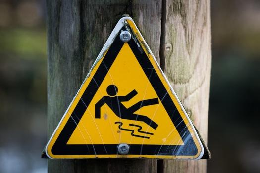sign-slippery-wet-caution-medium